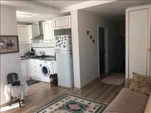 فروش آپارتمان یک خوابه 65 متری در آنتالیا کنیالتی محله لیمان با استخر